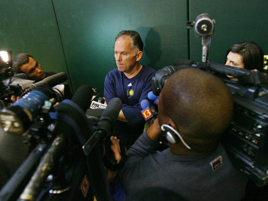 Then-coach Jim O'Brien was surrounded by media after Pacers practice on Dec. 9, 2007. Guard Jamaal Tinsley did not attend the practice after being present at a shooting that wounded a Pacer's trainer early that morning.