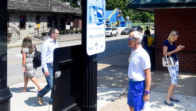 "The Metro Transit Authority has a bus stop on 21st Avenue near Vanderbilt University. The nMotion transit plan unveiled by MTA consultants last month identifies Broadway and West End Avenue for a type of transit known as ""arterial bus rapid transit."""