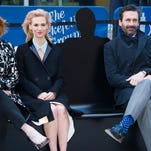 "Christina Hendricks, from left, January Jones and Jon Hamm appear at an unveiling of a bench dedicated to the ""Mad Men"" series in front of the Time & Life Building on Monday in New York. The bench shows a silhouette of Hamm's character Don Draper."