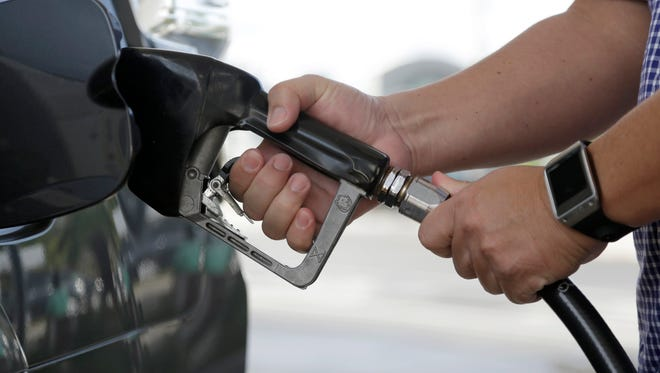 A motorist puts fuel in his vehicle at a Westar gas station, Friday, Jan. 23, 2015, in Miami. For the first time since 2009, most Americans are paying less than $2 a gallon. Just three months ago experts were shocked when it fell under $3. (AP Photo/Lynne Sladky) ORG XMIT: FLLS103