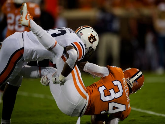 Auburn defensive back Javaris Davis (13) tackles Clemson