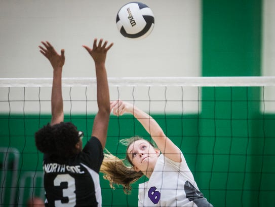 Central's Mara Perry hits against Ft. Wayne North Side's