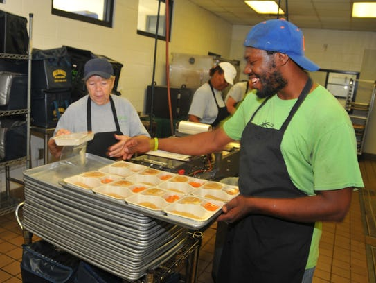 Bonnie Spillman and Michael Walker help prepare meals at Meals on Wheels in Cocoa.  Meals on Wheel was not on the list of community-based organizations recommended by theadvisory Community Action Board for funding in the new budget year.