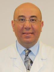 Dr. Magdy Girugius