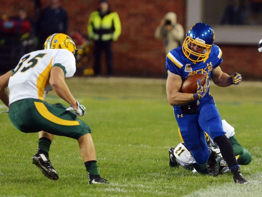 South Dakota State's Brady Mengarelli steps out of bounds as he approaches North Dakota State's Robbie Grimsley in Saturday's game at Coughlin-Alumni Stadium in Brookings, S.D. Oct 3, 2015.