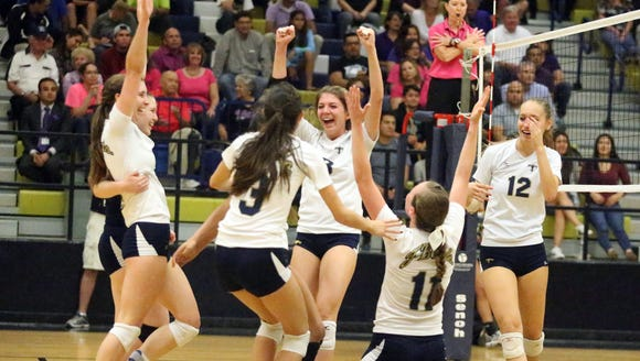 The Coronado volleyball team, including Carolina Mendez,