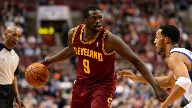 Cleveland Cavaliers forward Luol Deng (9) is defended by Philadelphia 76ers guard Evan Turner (12) during the first quarter at the Wells Fargo Center.