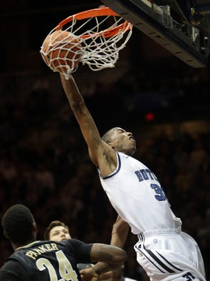 Kameron Woods of Butler, dunks a ball on a bizarre play in which the ball never cleared the bottom of the net, resulting in a no basket, Vanderbilt Commodores at Butler Bulldogs, men's basketball, Hinkle Fieldhouse, Indianapolis, Tuesday, November 19, 2013.