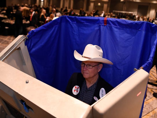 Brian Roquemore casts his ballot in the straw poll