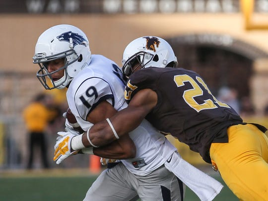 Wolf Pack wide receiver Wyatt Demps is tackled by Wyoming cornerback Antonio Hull during a game last season. Demps set a career high with six catches in the game.
