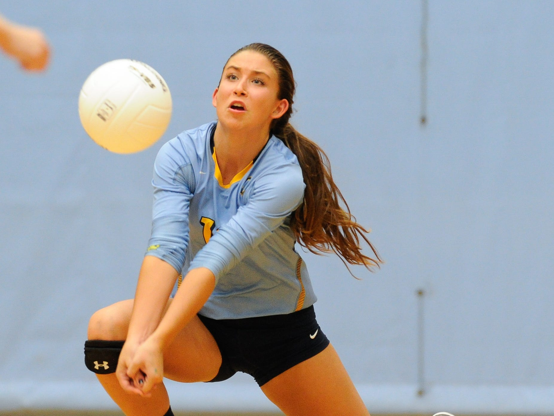Cape's #16 Isabelle Marsico with a bump in the second game against Conrad Thursday night at Cape Henlopen High School.