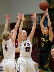 De Pere seniors Lizzie Miller (12) and Olivia DeCleene (4) trap Green Bay Preble's Hannah Beauchamp during a WIAA regional semifinal game at De Pere on Feb. 24. The Redbirds are allowing only 38.8 points per game.