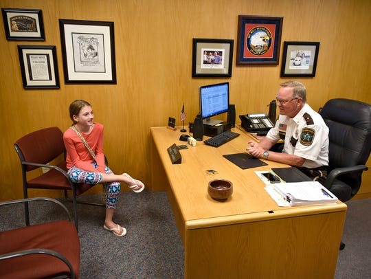 Callie Schaefer talks with Stearns County Sheriff John