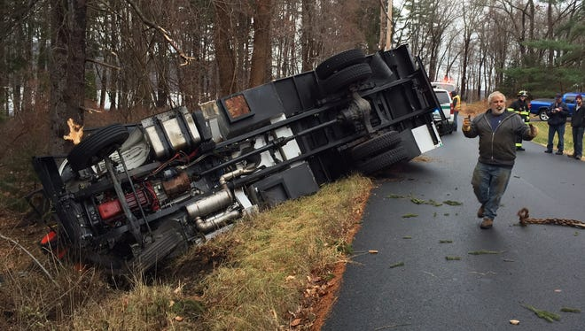 A tree service bucket truck rolled over on Mills Road in North Salem Monday, Dec. 12, 2016. The occupants were uninjured.
