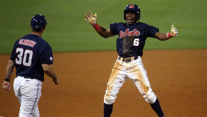 Shortstop Errol Robinson celebrates reaching third base during Ole Miss' series against LSU.