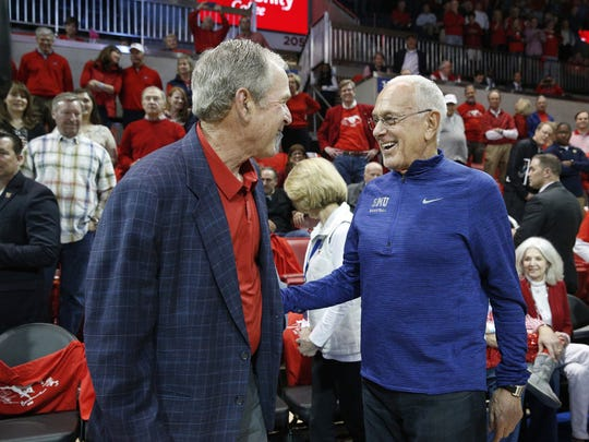 Former President George W. Bush greets former SMU basketball coach Larry Brown during the first half in Moody Coliseum on March 4, 2017 in Dallas.