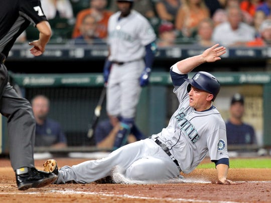 Seattle Mariners third baseman Kyle Seager slides into home plate to score a run against the Houston Astros during the fourth inning at Minute Maid Park.