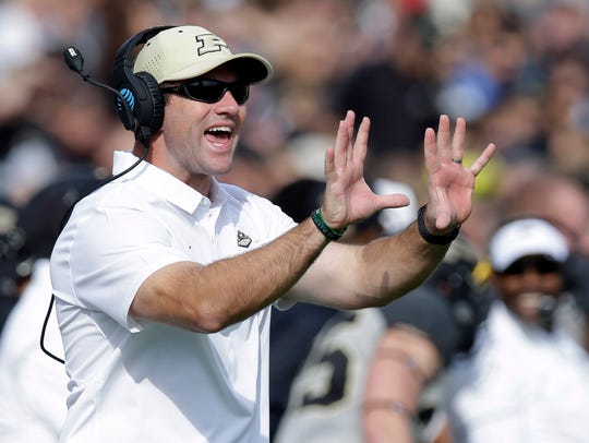 Purdue interim head coach Gerad Parker directs his