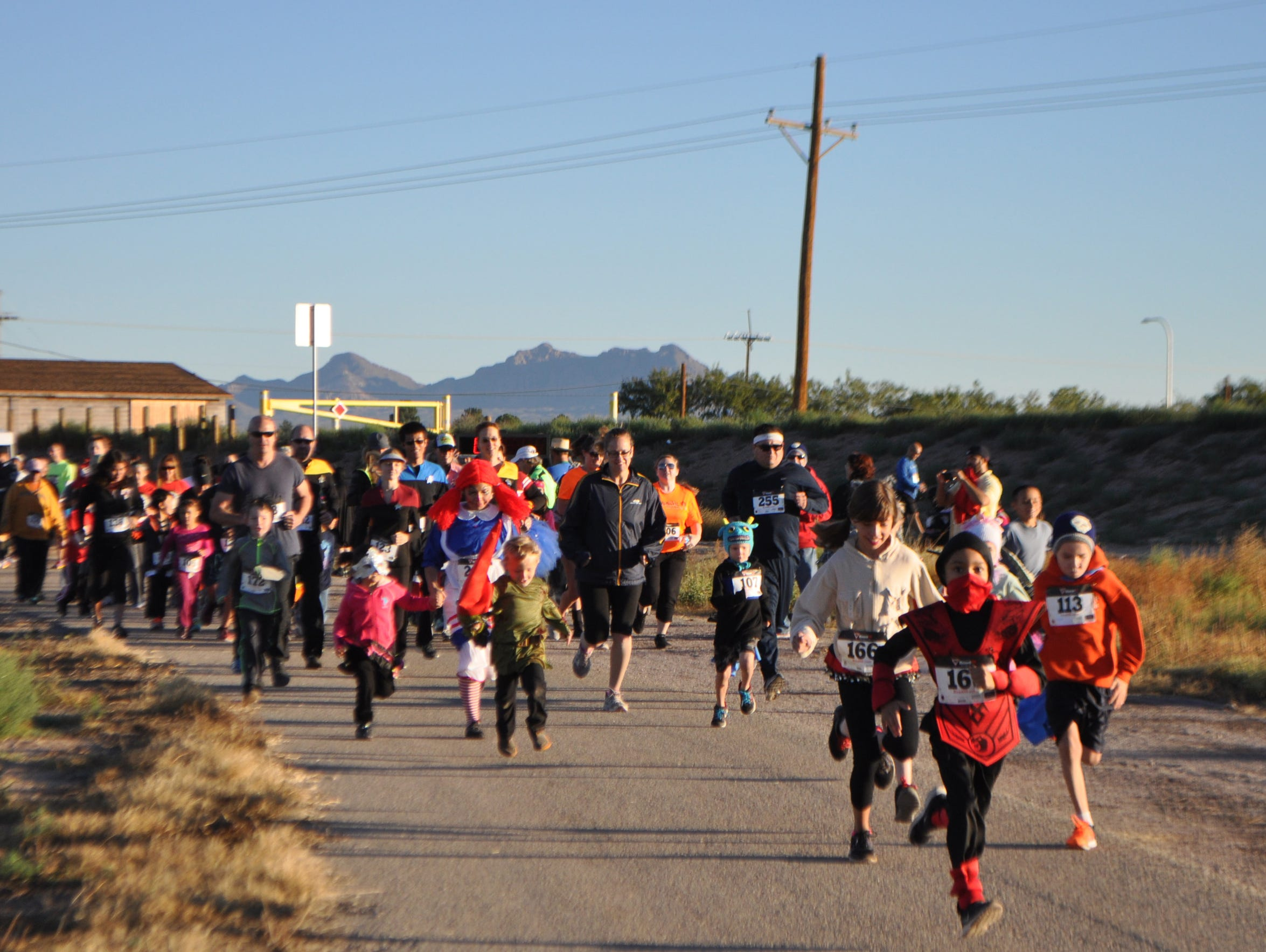 Adults and children participate in the 2014 Las Cruces