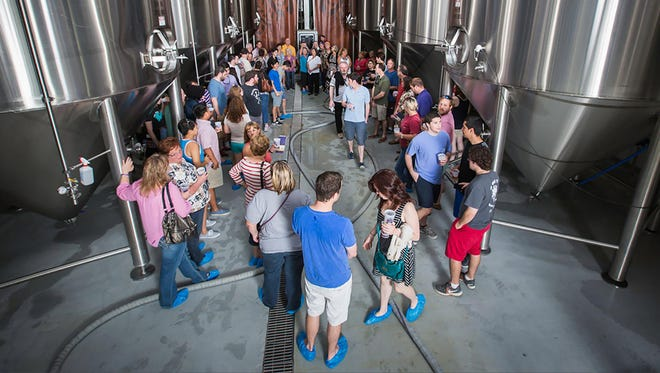 Visitors take a brewery tour at Bayou Teche Brewing, a must for the burgeoning beer geek.