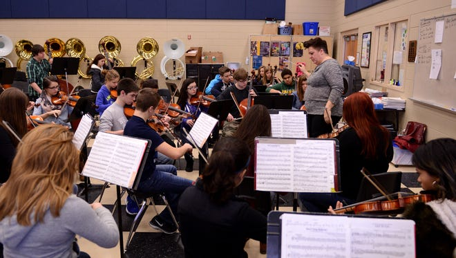 Audrey Nowak teaches orchestra class at Bay Port High School in Suamico in February 2015.