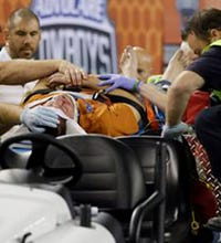Fan falls over railing at AT&T Stadium