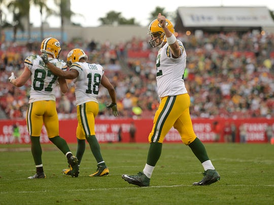 Green Bay Packers quarterback Aaron Rodgers (12) gives a thumbs-up to the crowd after the Packers scored against the Tampa Bay Buccaneers in the fourth quarter during the Week 16 game at Raymond James Stadium in Tampa, Fla.