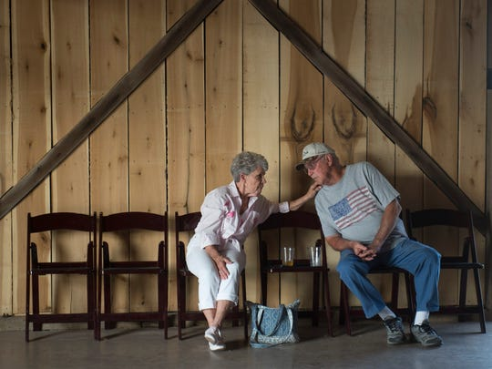 Earlene and Russell Schmidt enjoy a drink at Farmer & Frenchman Winery on Thursday, June 7, 2018.