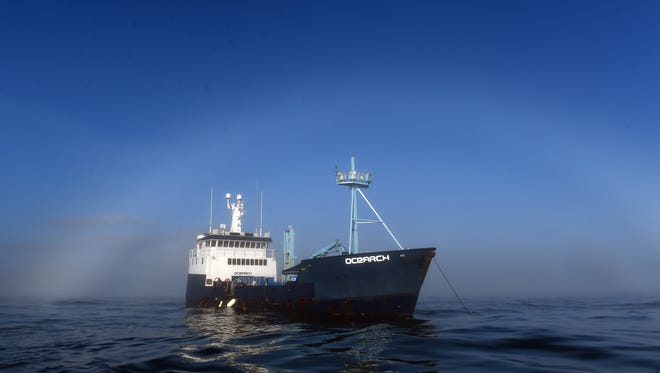 Anchored just a mile off the coast from Ponce Inlet, scientists aboard M/V OCEARCH are trying to catch great white sharks to attach tracking devices so they can monitor where they go during the year.