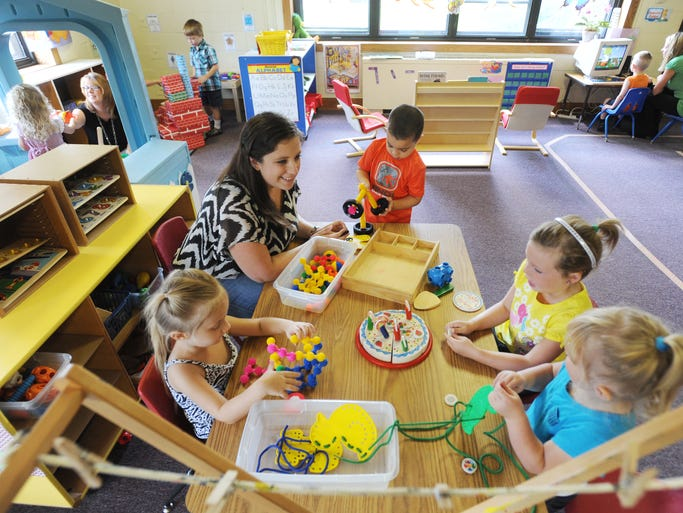 Teacher Jessica Pickrell works with a group of students at the World of Wonder preschool class at Muskingum County Head Start in Zanesville.