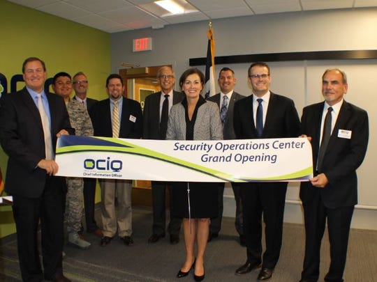 Gov. Kim Reynolds and Lt. Gov. Adam Gregg officially opened Iowa's Security Operations Center with a ribbon cutting on Tuesday, Oct. 3.