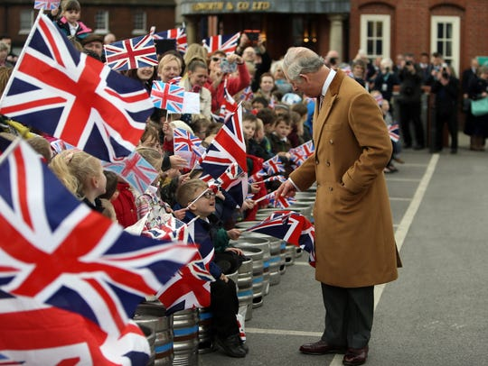 Prince Charles greets well-wishers while touring the