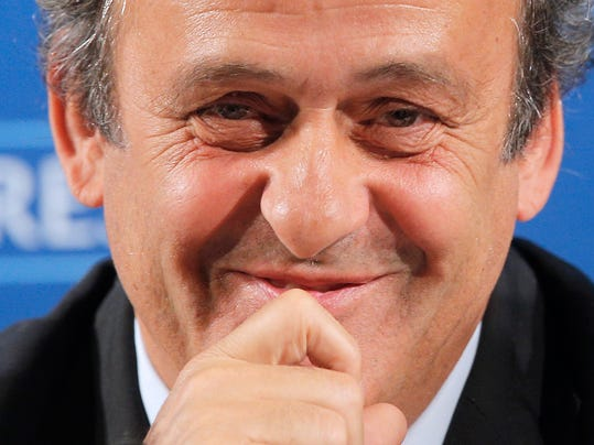 "FILE - In this Feb.22, 2014 file photo, UEFA President Michel Platini gestures during a press conference, one day prior to the UEFA EURO 2016 qualifying draw in Nice, southeastern France. Michel Platini will not challenge Sepp Blatter for the FIFA presidency, saying Thursday Aug.28, 2014  there was ""no shadow of doubt"" about his decision. The former France great was expected to avoid a contest against Blatter after a successful World Cup strengthened the FIFA president's position. (AP Photo/Lionel Cironneau, File)"