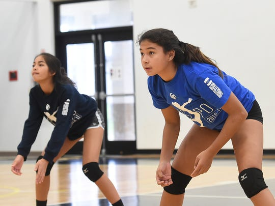 Members of the Haggan-NexGen Neni U14 girls volleyball team practice at the Tiyan High School Gym on June 22, 2017. The U14 team, along with the U18 team, will go onto compete in the USA Volleyball Girls' Junior National Championships in Minnesota.