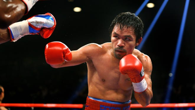Manny Pacquiao against Floyd Mayweather (not pictured) during their boxing bout at the MGM Grand Garden Arena.