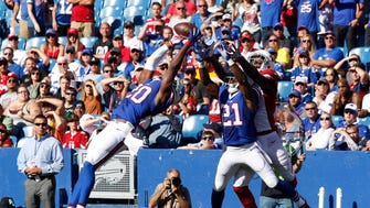 Buffalo Bills free safety Corey Graham (20) jumps to make a interception during the second half against the Arizona Cardinals at New Era Field. Bills beat the Cardinals 33-18.