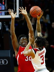 Nebraska Cornhuskers center Jordy Tshimanga (32) defends