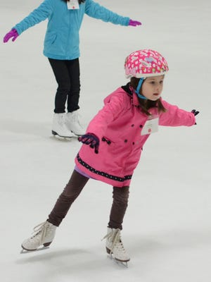 Claire Filthout learns how to balance on one skate as she takes a Learn to Skate class at the Novi Ice Arena.