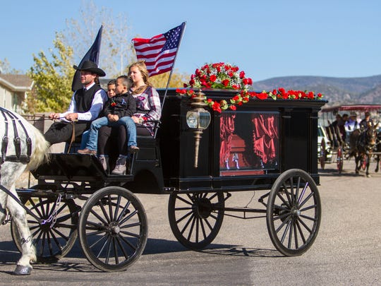 A horse-drawn carriage delivers Heather Alvarado's casket to the Enoch cemetery on Friday, October 13, 2017. Heather Alvarado was one of the victims in the Las Vegas shooting.