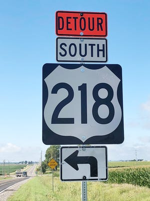 A truck turns onto the official detour for US 218 south of Van Horne, while work continues through the Fall of 2019 on the interchange at US 30 and 218.