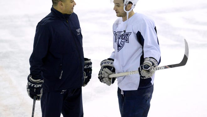 Ice Flyers coach Rod Aldoff, shown last season talking with former player Nick Lazorko, has his first home game Friday night since returning three weeks ago to take over team.