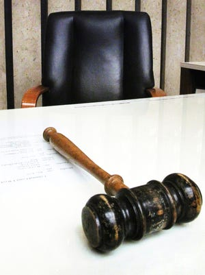 A gavel in a courtroom.