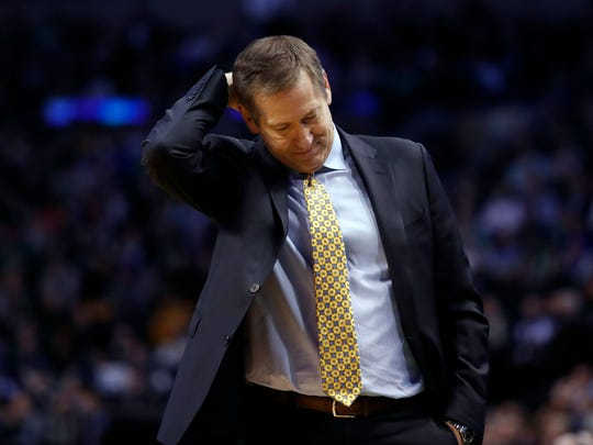 New York Knicks head coach Jeff Hornacek bows his head after his team turned the ball over during the first quarter against the Boston Celtics at TD Garden.