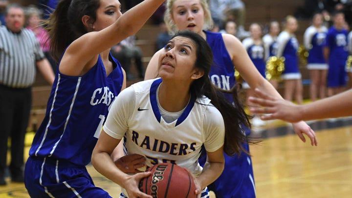 Reed's Larsa Guzman looks to shoot with Carson's Dajarrah