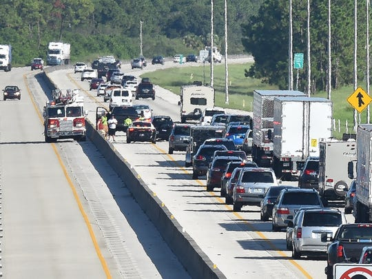 North-bound traffic along Florida's Turnpike slows down at the scene of a crash at the Becker Road Interchange during Hurricane Irma evacuations on Thursday, Sept. 7, 2017 in Port St. Lucie.
