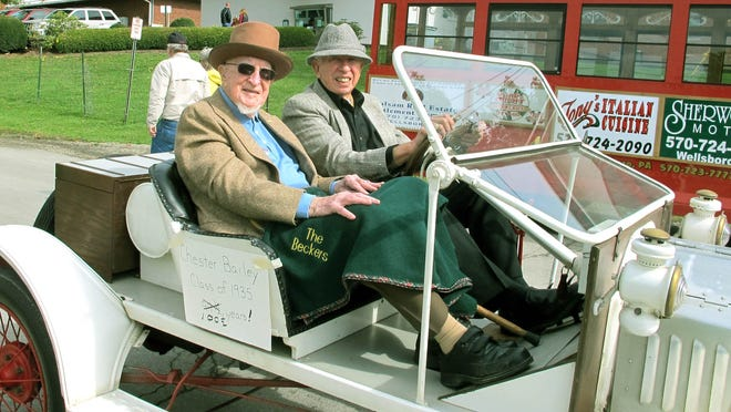 Chester Bailey, left, rides in the parade during the 2012 Fabulous 1890s Weekend held in Mansfield. Chester, a 1935 graduate of the school, was the oldest alumnus. He died Jan. 17 at age 102.