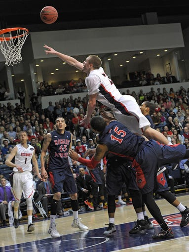 Craig Bradshaw gets fouled on a layup by  Robert Morris player Karvel Wqshington ,15,  during their game with Robert MorrisFriday March 21, 2014, in Nashville in Tenn.