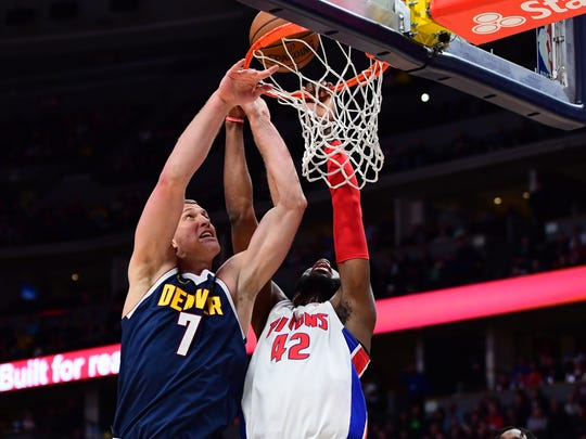 Feb 25, 2020; Denver, Colorado, USA; Detroit Pistons guard Donta Hall (42) and Denver Nuggets forward Mason Plumlee (7) compete for the ball in the second half at the Pepsi Center. Mandatory Credit: Ron Chenoy-USA TODAY Sports