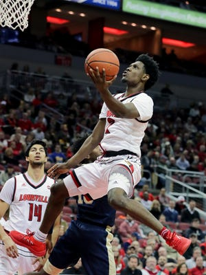 Louisville's Darius Perry goes up for the shot against Pittsburgh.