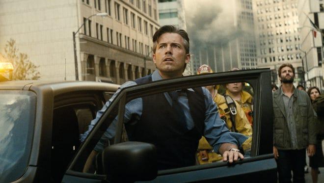 "Bruce Wayne (Ben Affleck) watches as a city crumbles in ""Batman v Superman: Dawn of Justice."""